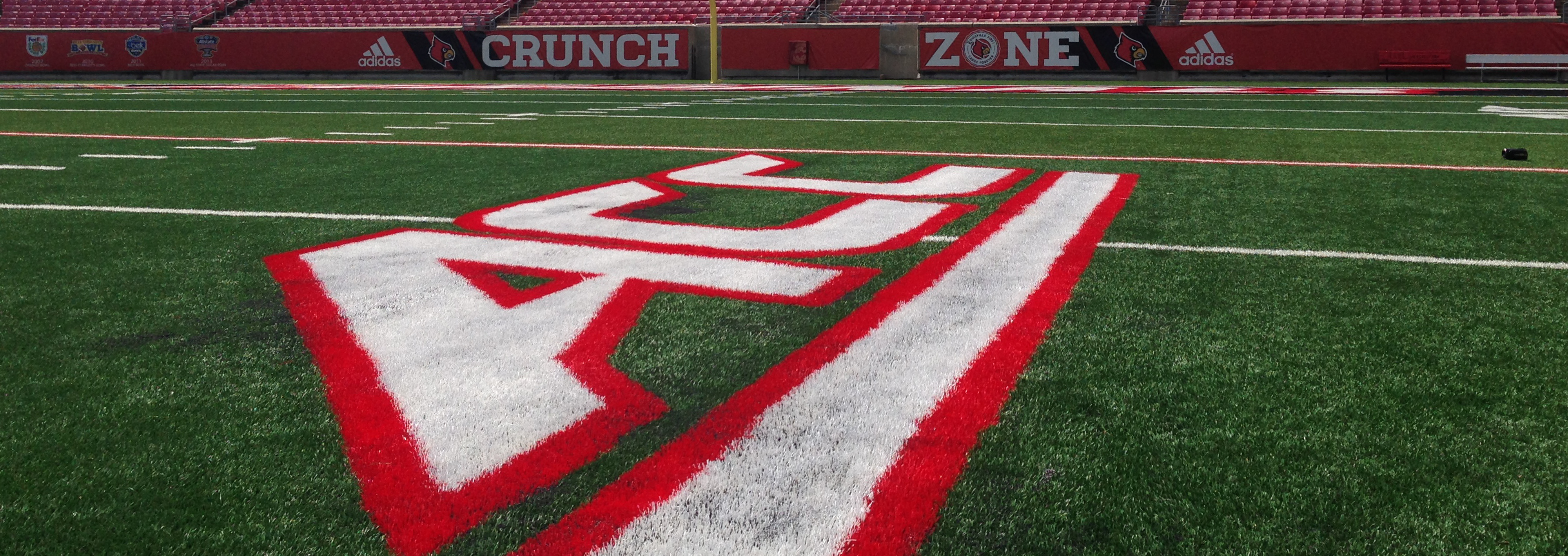 ACC Logo on Field at Papa John's Cardinal Stadium Summer 2014 Photo by Mark Blankenbaker Fitted