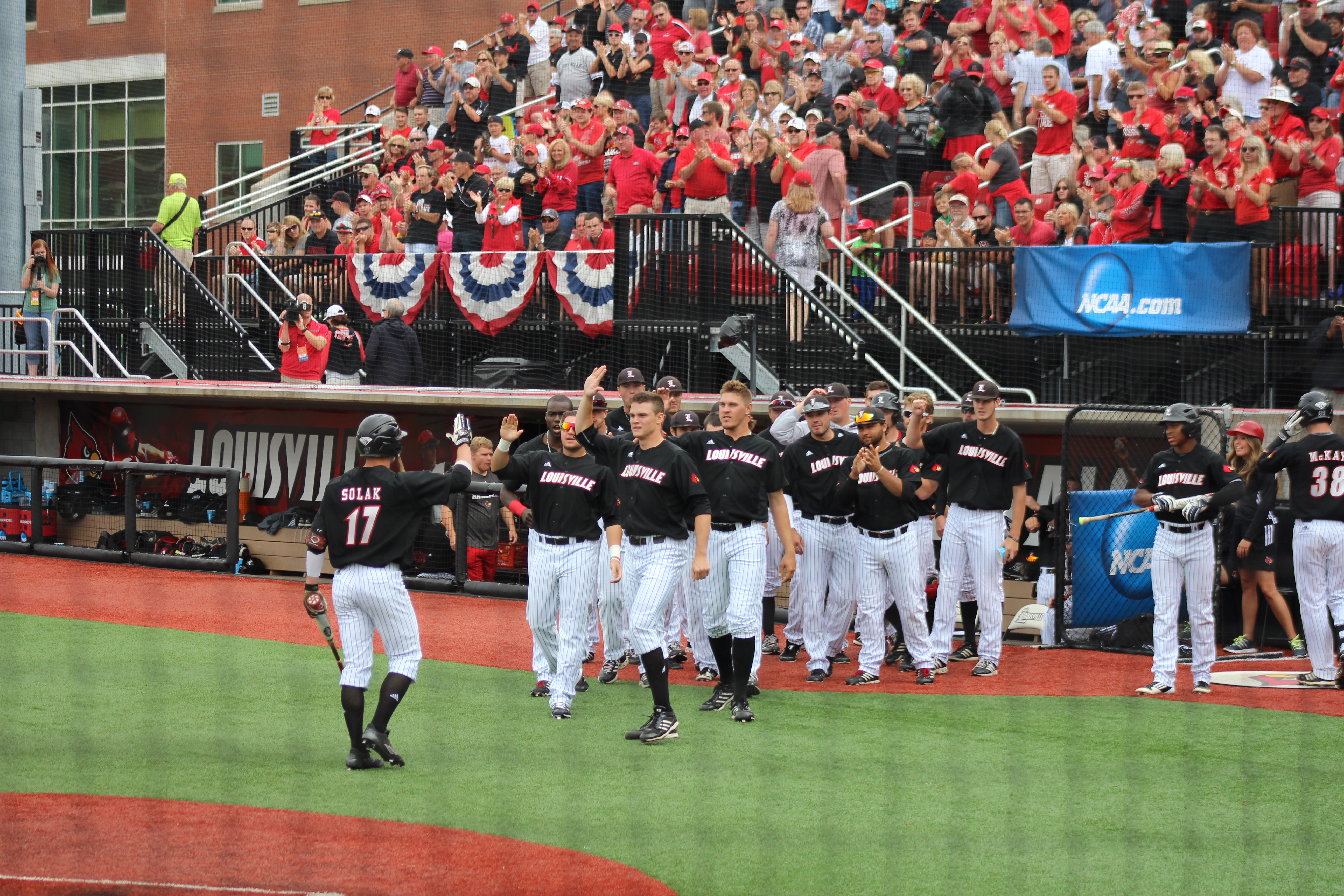 Nick Solak Run Celebration Louisville vs. Michigan 5-31-15 Jim Patterson Stadium Photo by Mark Blankenbaker