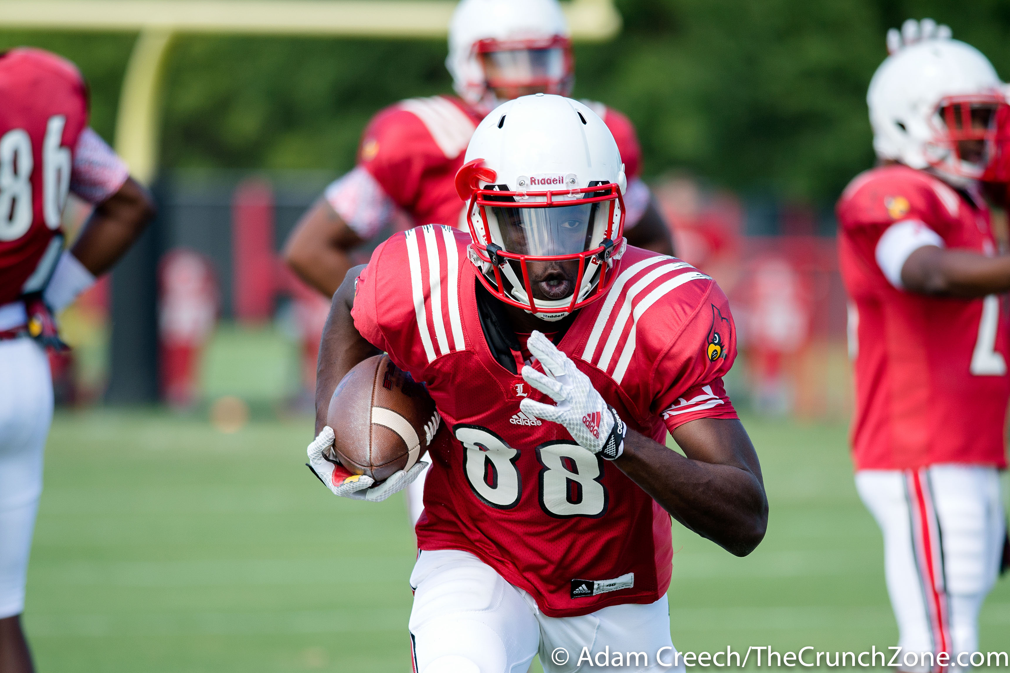 Louisville Cardinals wide receiver Javonte Bagley (88) runs the ball down the field during an open practice on August 11, 2015. Photo by Adam Creech