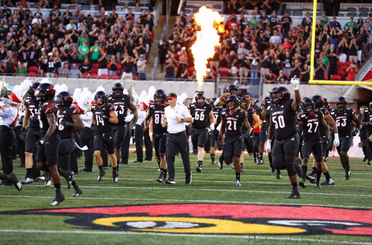 Entrance, Run Out. Scott Satterfield, Jean Luc-Childs Louisville vs. Notre Dame 9-2-2019 Photo by William Caudill, TheCrunchZone.com
