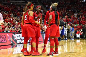Huddle, Asia Durr, Dana Evans, Jazmines Jones Louisville vs. Kentucky 12-9-2018 Photo by William Caudill, TheCrunchZone.com
