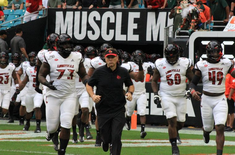 Scott Satterfield, Run out, Boosie Whitlow, Mekhi Becton Louisville vs. Miami 11-9-2019 Photo by Mark Blankenbaker, TheCrunchZone.com