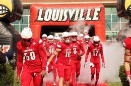 Jonathan Greenard, Cole Hikutini, Joshua Appleby, Lamar Jackson, James Quick, Louie the Cardinal Entrance Louisville vs. Syracuse 11-7-2015 Photo by William Caudill