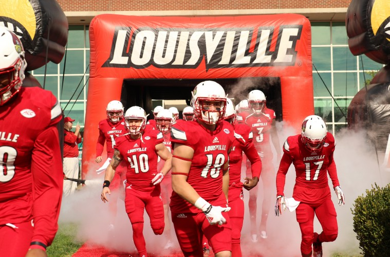 Cole Hikutini, Joshua Appleby, James Quick, Louie the Cardinal Entrance Louisville vs. Syracuse 11-7-2015 Photo by William Caudill