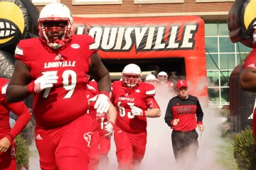 Kenny Thomas, Nathan Scheler, Bobby Petrino Entrance Louisville vs. Syracuse 11-7-2015 Photo by William Caudill