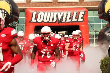 Kelby Johnson, T.C. Klusman Entrance Louisville vs. Syracuse 11-7-2015 Photo by William Caudill