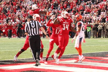 Jeremy Smith TD with James Quick, Lukayus McNeil Louisville vs. Syracuse 11-7-2015 Photo by William Caudill