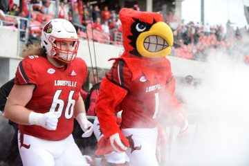 Louie the Cardinal, Cole Bentley, entrance Louisville vs. Wake Forest 10-27-2018 Photo by Austin Sullivan TheCrunchZone.com