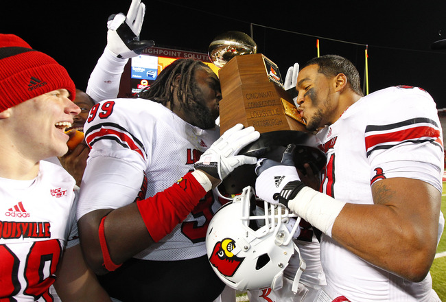 Jamaine Brooks and Marcus Smith with Big East Championship Trophy Celebration Louisville vs. Rutgers 2012 Photo by Mark Blankenbaker