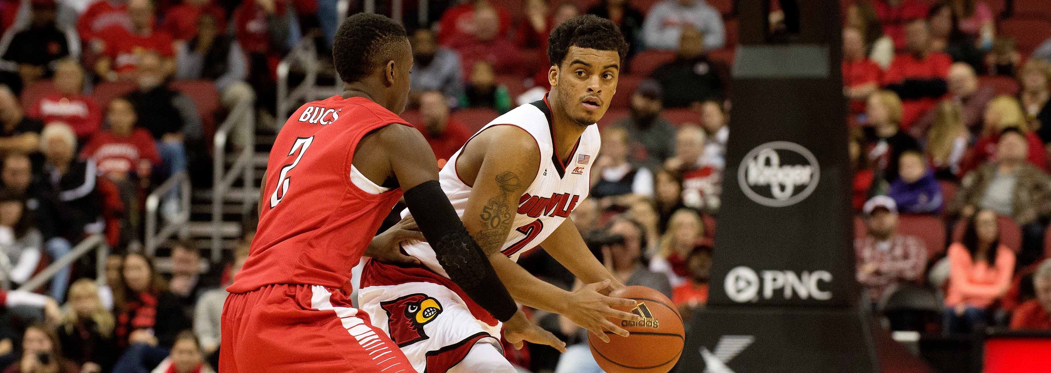 Quentin Snider Louisville vs. Barry 11-1-2014 Photo by Adam Creech Fitted