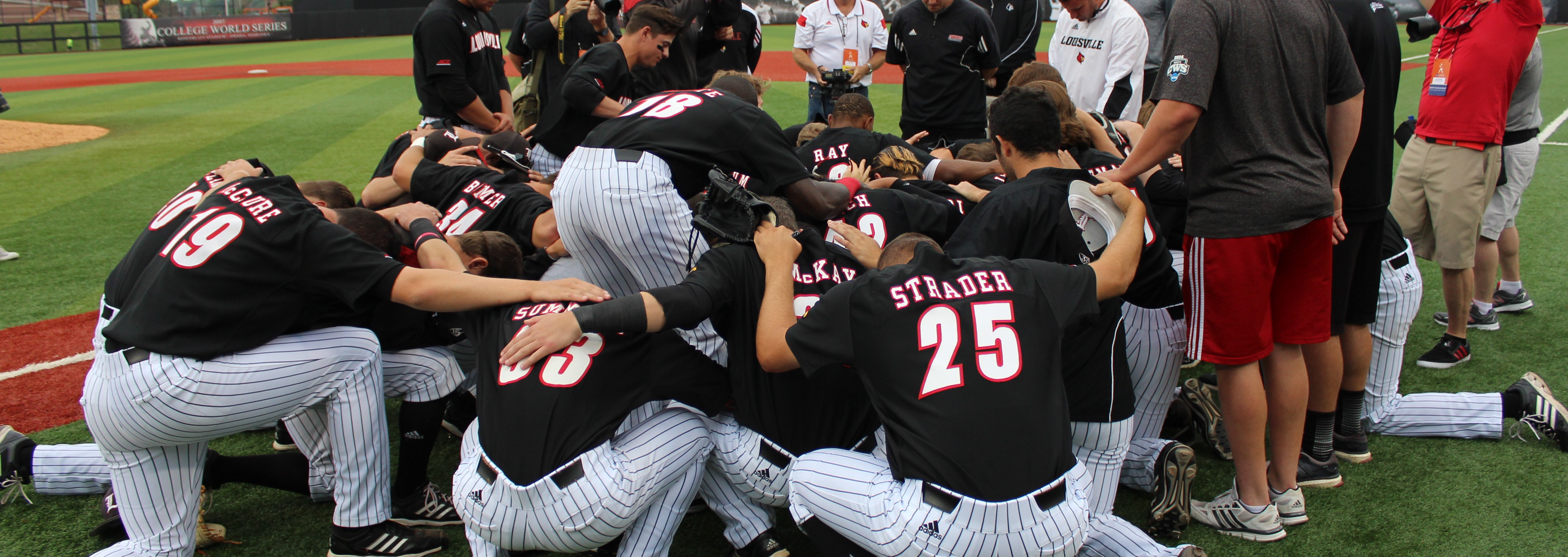 Prayer after Louisville Advances to 2015 Super Regional. Louisville vs. Michigan 5-31-15 Photo by Mark Blankenbaker Fitted