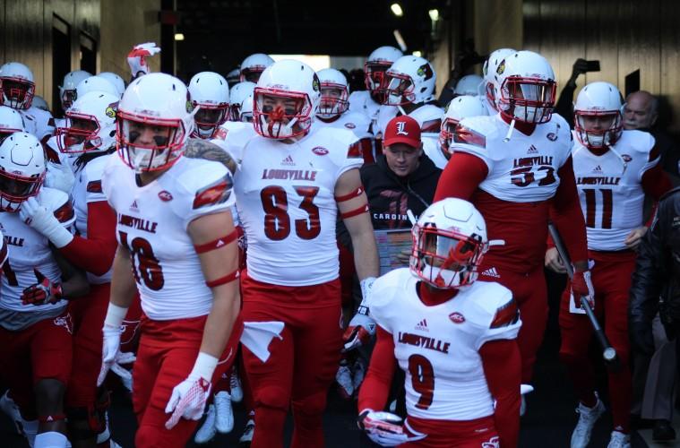 Cole Hikutini, Micky Crum, Traveon Samuel, Bobby Petrino, Nick Dawson-Brents Louisville vs. Pittsburgh 11-21-2015 Photo by Mark Blankenbaker