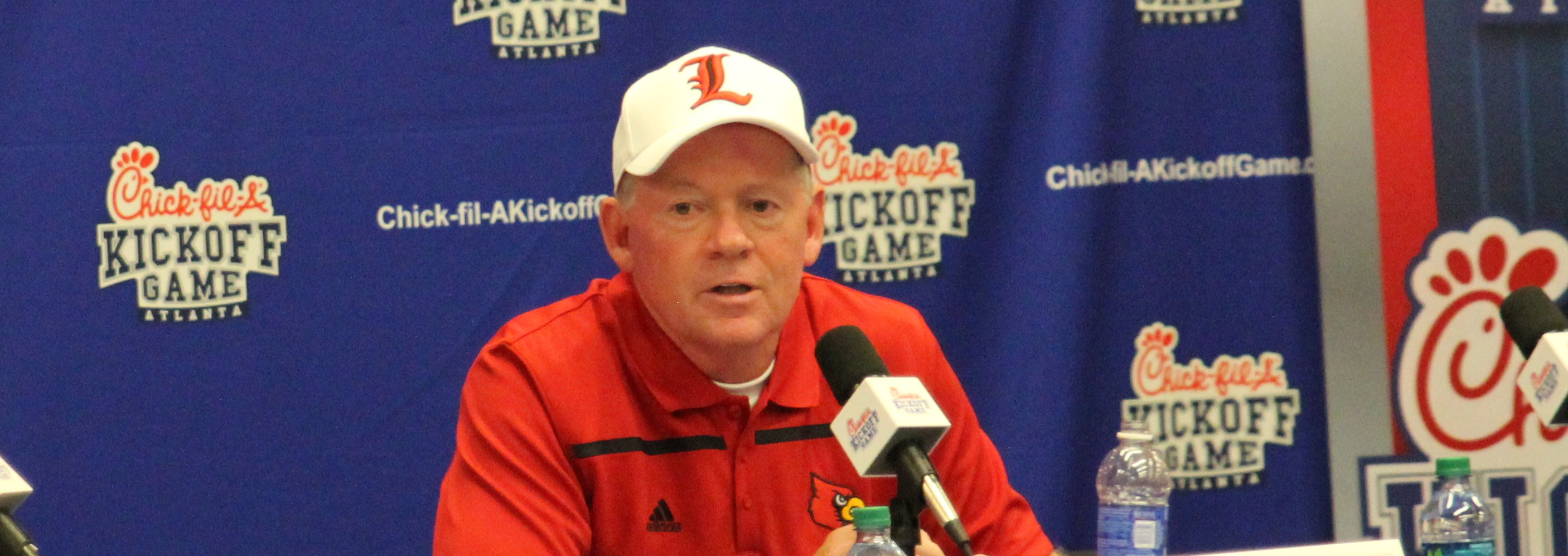 Bobby Petrino after a 31-24 loss to Auburn in the Chick-fil-A Kickoff. Louisville vs. Auburn 2015 in the Georgia Dome. Photo by William Caudill
