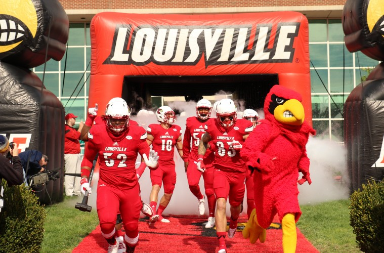 Nick Dawson-Brents, Micky Crum, Cole Hikutini, Louie the Cardinal Entrance Louisville vs. Syracuse 11-7-2015 Photo by William Caudill