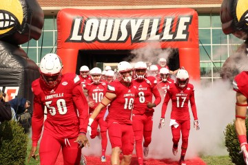 Jonathan Greenard, Cole Hikutini, Joshua Appleby, Lamar Jackson, James Quick, Louie the Cardinal Entrance Louisville vs. Syracuse 11-7-2015 Photo by William Caudill