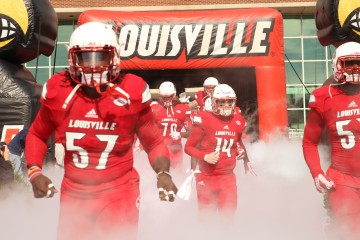 Finesse Middleton, Kyle Bolin,Toriano Roundtree Entrance Louisville vs. Syracuse 11-7-2015 Photo by William Caudill