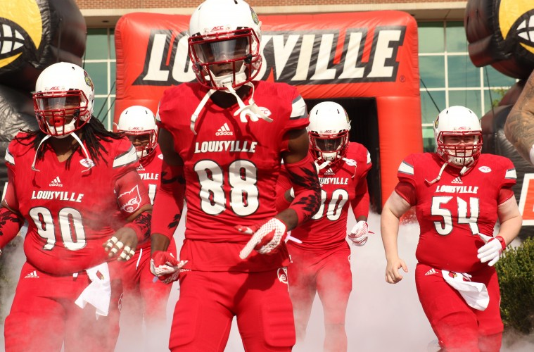 Johnny Richardson, Javonte Bagley, Charles Standberry, Kevin Austin Entrance Louisville vs. Syracuse 11-7-2015 Photo by William Caudill
