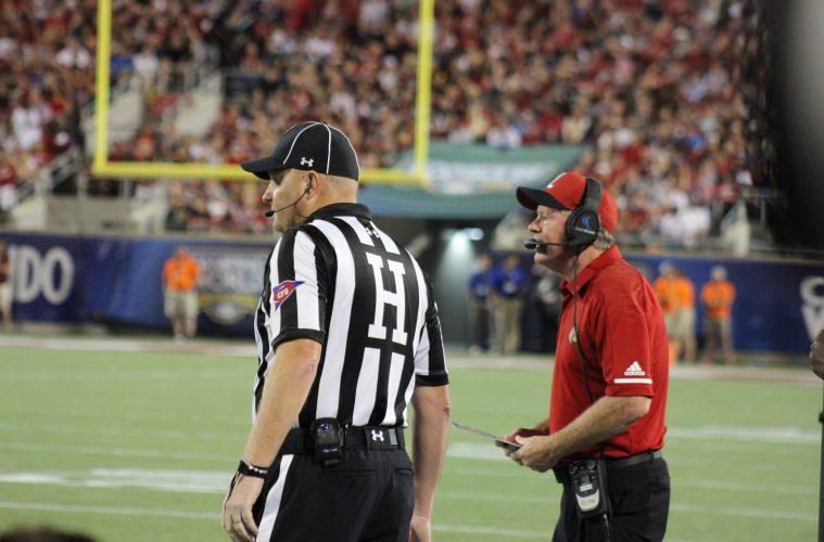 Bobby Petrino, Head Linesman Louisville vs. Alabama 51-14, 9-1-2018. Photo by Ashley Satterfield, TheCrunchZone.com
